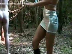 Dom with fantastic body hits pinioned slave on his bum and plus back with a whip in the forest