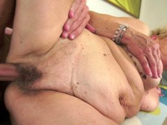 A plump granny is getting fucked and also she is sucking a knob