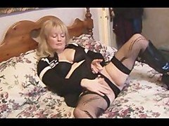 Aged busty blonde chick in stockings and besides mini skirt