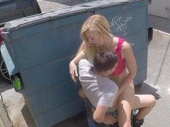 A blonde is pressed against the dumpster and she is fucked well