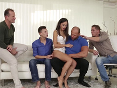 A hot brunette is with four guys, receiving their large dicksc