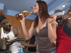 A white bitch is getting several black cocks inside her meaty holes