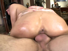 Tattooed honey is doing anal sex while riding like a cowgirl
