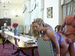 A blonde is getting fucked on top of the dinning room table