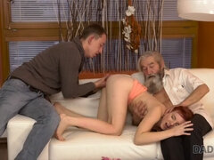 Redhead girl fucked by two older men