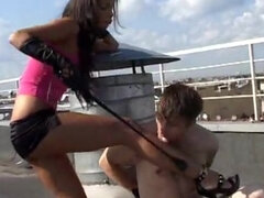 Stuning mistress cropping & dominating two feet slaves on the roof