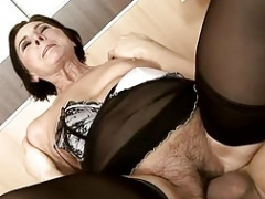 Hirsute granny In Stockings Pleased Her Young Lover