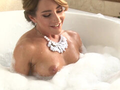 Savannah Fox teasing her holes in the soapy mess