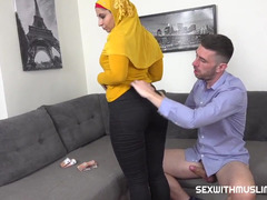 Muslim female in a yellow hijab does it for money