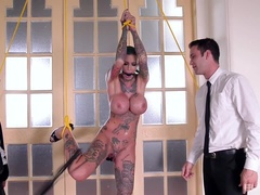 Calisi Ink enjoys a deep double penetration while bound by the wrists