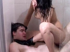 Chubby slave trampled and strangulated in the shower
