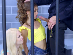 A duo sluts in their prison cell are getting fucked by a horny cop