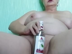 Sexually available mom Margarita masturbates with bottle