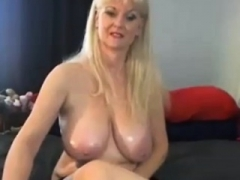 Sexy busty granny enjoying with huge heavyweight dildo on online camera