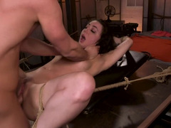 Tied and naked girl is being fucked in her pussy and ass