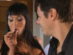 Bitchy brunette domina in leather smoking and screwing hard