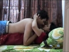 Indian couple having passionate sex in their bedroom