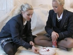 A duo girls messing school uniforms
