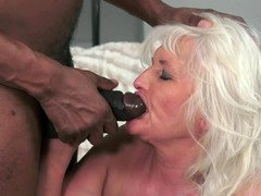A granny gets her huge saggy titties groped by a huge black dude