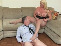 Full-bosomed mistress in stockings treats husband like a slave