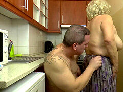 busty Hungarian grannie Kitti bangs in the kitchen
