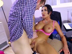 A lady that has terrific huge tits is fucked in the office