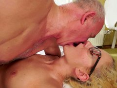 A blonde with glasses is getting a purple pole in her juicy pussy on the side