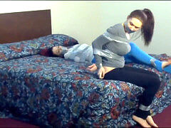 Duct Taped ball-gagged 2 women