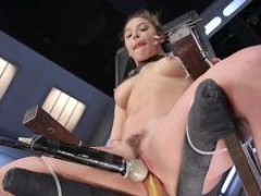 Restrained up gal has fun on fucking machine