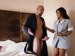 Big-cocked guy can't avoid banging with busty maid from hotel