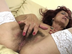 This mama gets fisted by a hot babe