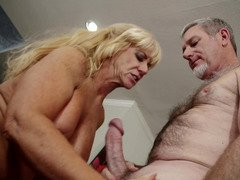 Blonde granny gives a blow job to a aroused gray lad