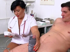 brunette mature nurse in uniform gives handjob to her client for cum on saggy tits