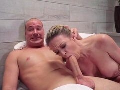 Dee Williams fucks her son's buddy in the sauna right next to him