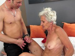 A granny is getting her fuck hole stretched wide open by a young-looking penis