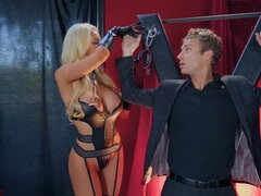 Big titted mistress Nicolette Shea plays kinky games with her slave.