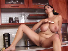 A heavyweight chick is in the kitchen and furthermore she is playing with her huge tits