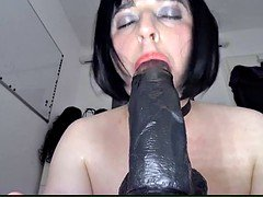 Crossdresser blows off and gags on immense Black Dildo