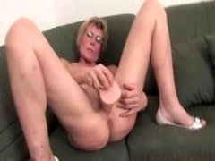 Horny aged woman plasuring her soaked pink slit