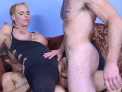 A blonde with awesome pigtails and large tits is fucking two men