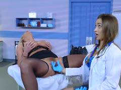 A brunette doctors examines her hot blonde patient in the office