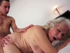 A heavyweight granny is getting her honey pot destroyed by a young and fresh dude