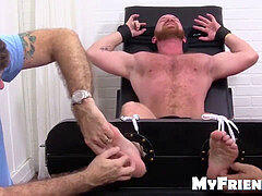 Hairy gay dude red gets bound down and kittled on the chair