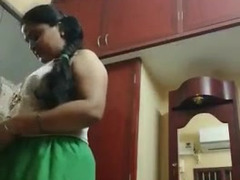 Indian BBW changes her clothes in front of a camera