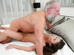 A bimbo that loves mature lads is fucked on the bed deeply