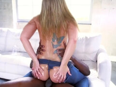 Addison Lee's bouncy oiled booty gets stretched by a bbc on the couch
