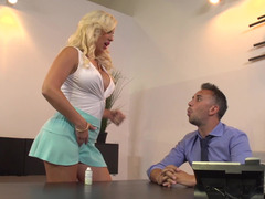 A blonde unclothes in the office & there is a lot of passion