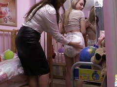 Betty changes Chloe's soaked Attends Specific Care diaper
