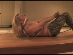 Adrienne bound and gagged on a table