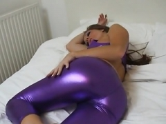 Sexy British Cathy in Shiny Purple Spandex
